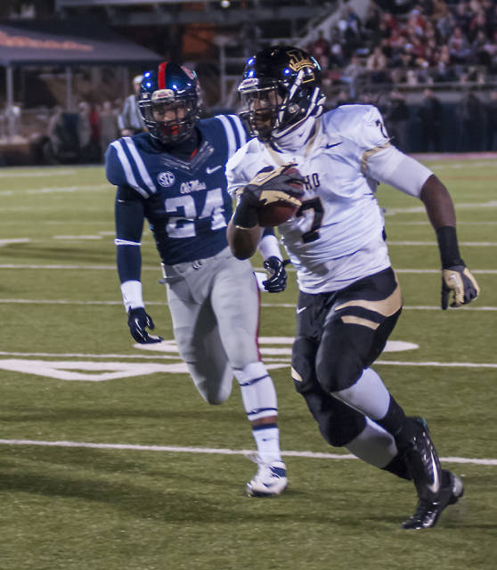 James Baker runs the ball during Idaho's 59-14 loss at Ole Miss. A 42-yard reception by Baker in the second quarter set up the Vandals first touchdown.