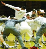 Idaho Men's Basketball team starts game with their routine. Vandals won with 35 point lead against LCSC, Friday at UI Memorial Gym.