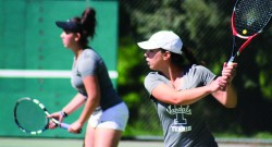 Senior Rita Bermudez and freshman Maria Tavares wait to return the ball during doubles competition against Portland State Sunday in Moscow.