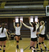 Members of the Idaho volleyball team celebrate an early point during a scrimmage Saturday against LCSC at the Memorial Gym. The Vandals earned a 3-0 sweep of the Warriors.