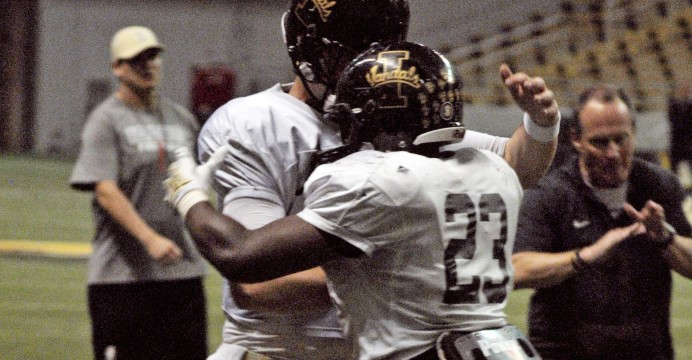 Junior runningback Aaron Duckworth and sophomore quarterback Jake Luton celebrate after a touchdown during the Silver and Gold scrimmage Friday in the Kibbie Dome.