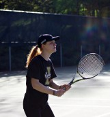 Marianna Petrei, a Vandal tennis player in deep concentration as she returns the ball to her opponent.
