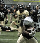 Junior runningback Aaron Duckworth runs the ball into the endzone during the Silver and Gold scrimmage Friday in the Kibbie Dome.