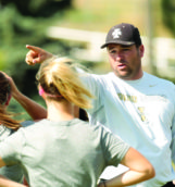 Associate Head Coach Josh Davis gives direction during Saturday's soccer practice at Guy Wicks Field.
