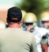 Idaho head football coach Paul Petrino gives instructions during practice Aug. 16 on the SprinTurf.