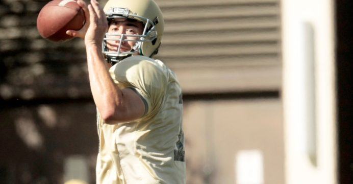 Junior quarterback Matt Linehan throws a pass during Tuesday's practice on the SprinTurf.