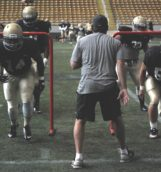 The defensive line runs through drills before the scrimmage Saturday in the Kibbie Dome.