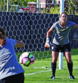 Senior goalkeeper Faith Sugerman shouts instructions to teammates during Tuesday's practice at Guy Wicks Field.
