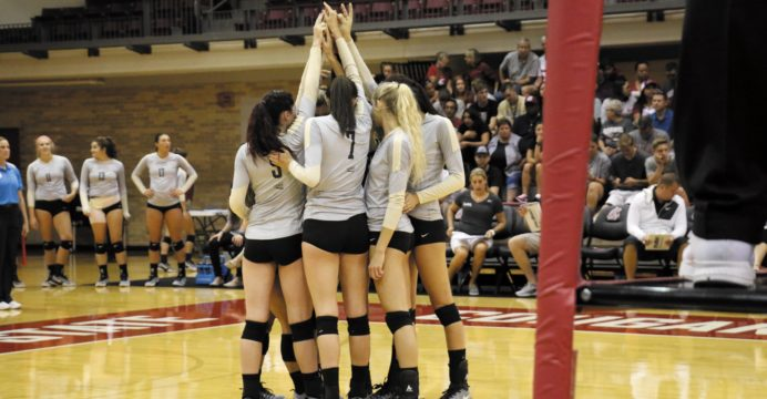 Vandal starters come together before starting a set in Bohler Gym on Saturday.