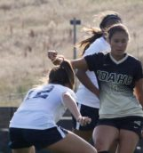 Sophomore midfielder Megan Goo drives down the field during Friday's game against Gonzaga at Guy Wicks Field.