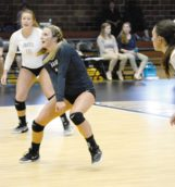 Senior defensive specialist Terra Varney returns the ball as teammates junior outside hitter Klaree Hobart and junior outside hitter Becca Mau back her up during the game Thursday in Memorial Gym.