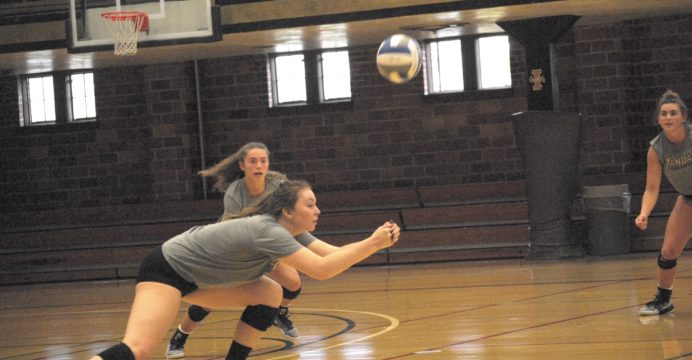 Sophomore outside hitter Kaela Straw dives for the ball during practice Thursday in Memorial Gym.