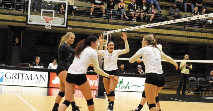 The women's volleyball team celebrates after a successful play against Northern Colorado Saturday night.