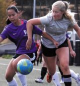 Tessa Hassinger fights for the ball during Saturday's club soccer game against Washington on the SprinTurf.