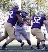 Redshirt freshman Mike Linehan fights off the Washington defense Sept. 10 in Seattle.