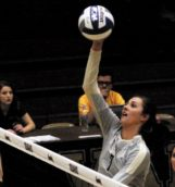 Junior middle blocker Torrin Crawford spikes the ball during Saturday's game against Northern Arizona in the Memorial Gym.