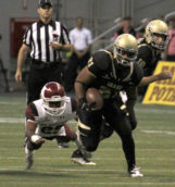 Sophomore running back Isaiah Saunders breaks through the Aggie defense Saturday in the Kibbie Dome.