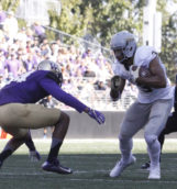 Senior tight end Deon Watson dodges a Husky Sept. 10 in Seattle.