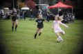 Freshman midfielder Myah Merino fights off defenders and passes the ball during the game Sunday at Guy Wick's Field.