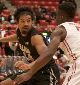 Junior small forward Jordan Scott drives into the paint during Wednesday's game against Washignton State in Pullman.