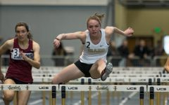 W. Track and Field: Hurdling over roadblocks